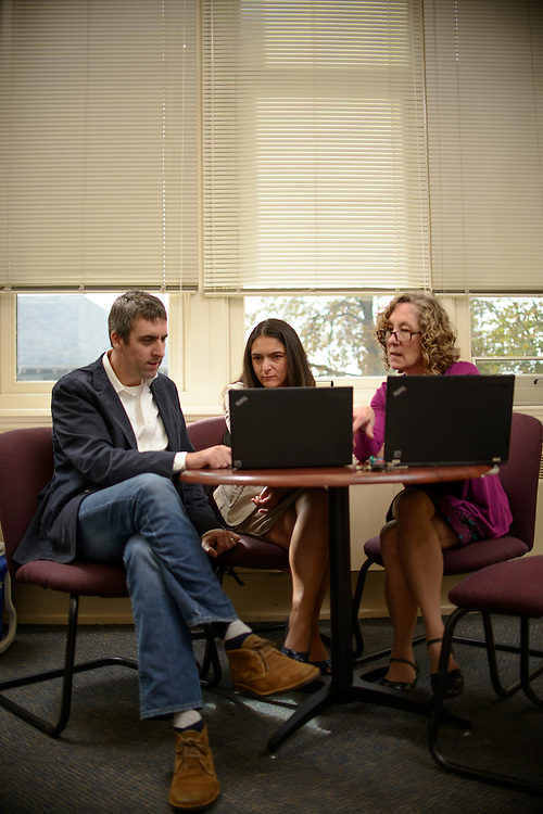 Photo by Matt Roth<br /> <br /> Lebanon Valley College's Associate Dean for Academic Affairs Ann Damiano, right, teaches Art History professor Dr. Grant Taylor, left, and Philosophy professor Dr. Noelle Vahanian, middle, how to use the school's student data repository software &quot;TracDat&quot; Monday, September 23, 2013.