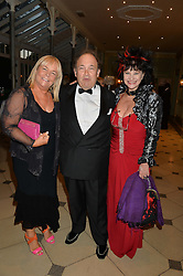 Left to right, LINDA ROBSON, OLIVER DE ROTHSCHILD and KAREN MANN at 'A Night of Champions' an evening to raise funds for the Mo Farah Foundation held at The Hurlingham Club, London on 28th August 2014.