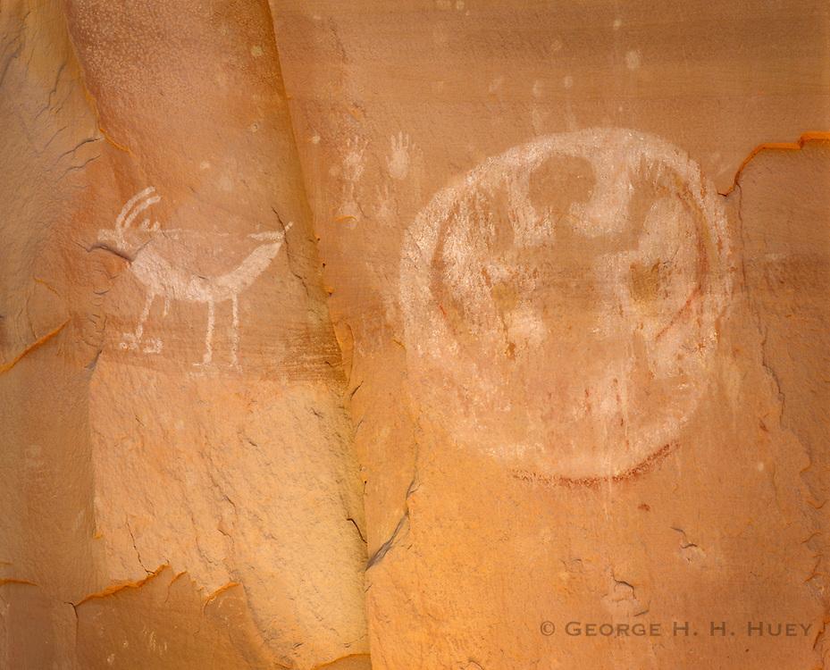0111-1011 ~ Copyright:  George H. H. Huey ~ Kayenta Anasazi pictographs, with Hopi Indian Fire Clan symbol at right.  Tsegi Canyon. Navajo National Monument, Arizona.