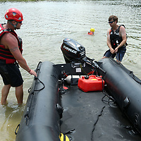 TJ Harmon, left, a firefighter with the Amory Fire Department, helps Ben McMinn, a Lieutenant with the Hernando Fire Department, pull a boat into the lake at Veterans Park in Tupelo on Thursday as they train in search and rescue and get the boats out on the water for practice. The training was part of the Homeland Security Task Force 1 Training.