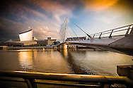 A View of the Media City Bridge and the Imperial War Museum North at Night. Salford, Manchester.