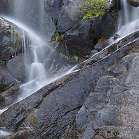 Small waterfall cascade in Yosemite National Park, California, early summertime.