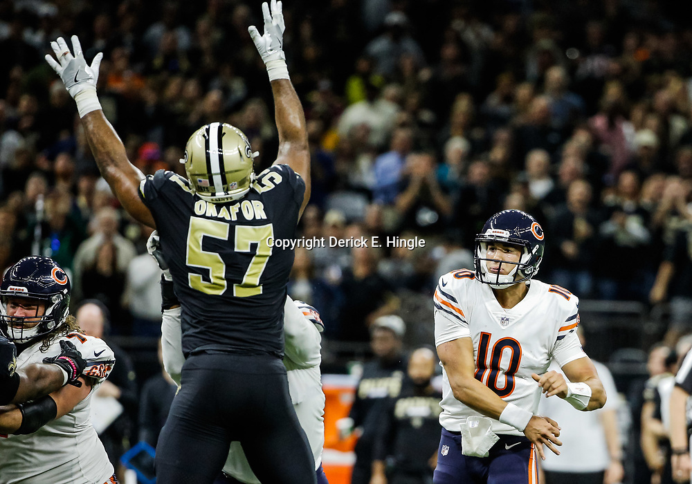 Oct 29, 2017; New Orleans, LA, USA; Chicago Bears quarterback Mitchell Trubisky (10) throws as New Orleans Saints defensive end Alex Okafor (57) pressures during the second half of a game at the Mercedes-Benz Superdome. The Saints defeated the Bears 20-12. Mandatory Credit: Derick E. Hingle-USA TODAY Sports