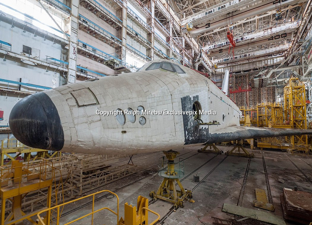 Urban Explorer Finds The Sad Remains Of The Soviet Space Shuttle Program<br /> <br /> Ralph Mirebs, an urban explorer and photographer in Russia, has revealed extraordinary photos of Soviet space shuttle prototypes gathering dust in an abandoned hangar in Kazakhstan.<br /> <br /> The abandoned hangar is located at the Baikonur Cosmodrome in Kazakhstan, which is still in operation today (with the close of NASA&rsquo;s shuttle program, Russian Soyuz shuttles are the only way for astronauts to reach the International Space Station). The Buran prototype shuttles found by Mirebs, however, are from an earlier era &ndash; they are the last remnants of a space program that began in 1974 and was finally shuttered in 1993. The only operational Buran shuttle, Orbiter 1K1, completed one unmanned orbital flight before it was grounded. Unfortunately, this shuttle was destroyed in a hangar collapse in 2002.<br /> <br /> many areas of the huge Baikonur Cosmodrome are still in business today, and that it is from here that the Soyuz rockets are launched, supplying the International Space Station in supplies and crew members<br /> Mirebs&rsquo; photos show this forgotten space program derelict and frozen in time.<br /> &copy;Ralph Mirebs/Exclusivepix Media
