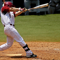 June 05, 2011; Tallahassee, FL, USA; Alabama Crimson Tide center fielder Taylor Dugas (1) hits a two run single during the seventh inning of the Tallahassee regional of the 2011 NCAA baseball tournament against the UCF Knights at Dick Howser Stadium. Alabama defeated UCF 12-5.  Mandatory Credit: Derick E. Hingle