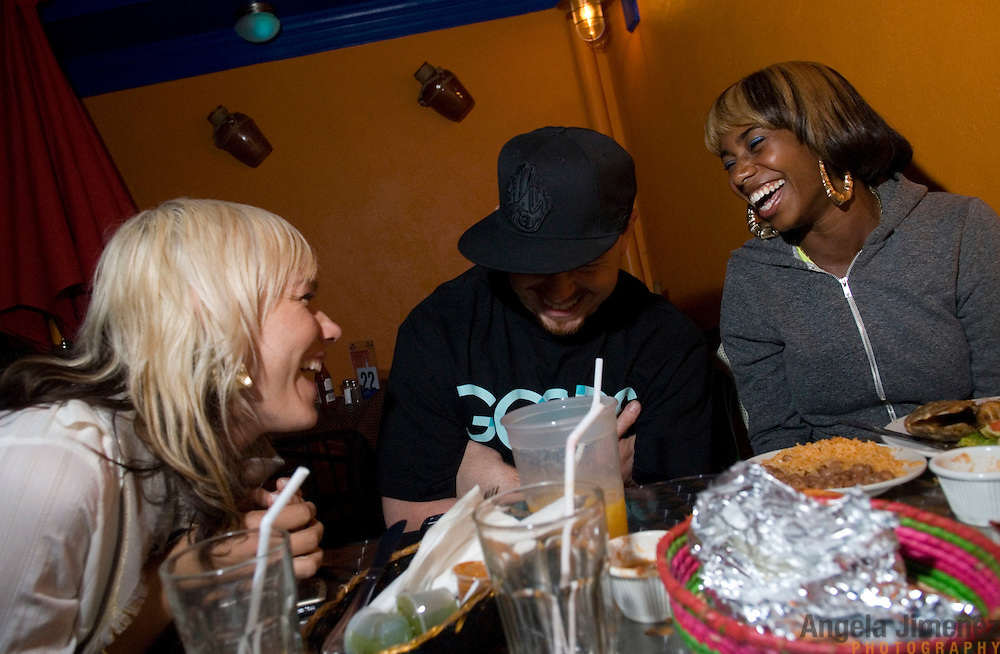 Date: 6/19/08.Desk: STL.Slug: NITE.Assign Id: 30063895A..Santi White, right, aka the singer Santigold, has dinner with her friends Craig Wetherby, a photographer, center, and April Roomet, a stylist, at Castro's on Myrtle Avenue in Fort Greene, Brooklyn on June 19, 2008.....Photo by Angela Jimenez for The New York Times .photographer contact 917-586-0916