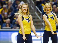 Jan 7, 2017; Morgantown, WV, USA; A West Virginia Mountaineers dance team member performs during a timeout during the first half against the TCU Horned Frogs at WVU Coliseum. Mandatory Credit: Ben Queen-USA TODAY Sports