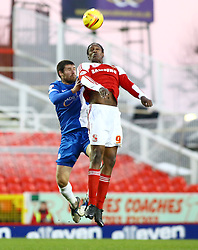 Swindon Town's Nile Ranger in action with Peterborough United's Michael Bostwick - Photo mandatory by-line: Joe Dent/JMP - Tel: Mobile: 07966 386802 11/01/2014 - SPORT - FOOTBALL - County Ground - Swindon - Swindon Town v Peterborough United - Sky Bet League One