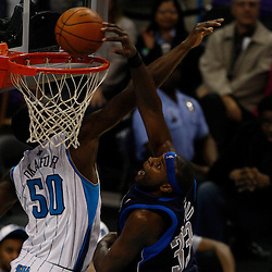 Mar 22, 2010; New Orleans, LA, USA; Dallas Mavericks center Brendan Haywood (33) dunks over New Orleans Hornets center Emeka Okafor (50)during the second half at the New Orleans Arena. Mandatory Credit: Derick E. Hingle-US PRESSWIRE