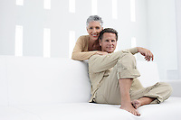 Couple in living room portrait