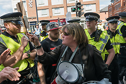 June 3, 2017 - London, UK - Maidenhead, UK. 3rd June 2017. Police surround Disabled People Against Cuts protesters blocking a main road into the town in protest in Theresa May's constituency against the Tory government, the first in the world to be found guilty of the grave and systematic violations of disabled people's human rights by the UN and tell them they must get off the street.  Paula Peters lets the police know what she thinks of them after they have threatened her with arrest to get her to move off the street.  The cuts they have made since 2010 have had 9 times the impact on disabled people as on any other group, 19 times more for those with the highest support needs. DPAC say Tory polices are heartless and are starving, isolating and ultimately killing the disabled. They marched from the station to protest on the high street with a straw 'Theresa May - Weak and Wobbly' and the message 'Cuts Kill' and after a hour of protest returned calling on voters to vote for anyone but her to the station and blocked one of the busiest roads into the town for around 15 minutes. Peter Marshall ImagesLive (Credit Image: © Peter Marshall/ImagesLive via ZUMA Wire)