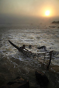A fisherman checks a basket at Wagenia Falls in the middle of the Congo River, near Kisangani, DR Congo.