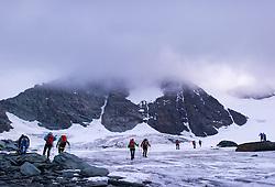 THEMENBILD - Bergsteiger am Ködnitzkees unterm Großglockner. Der Großglockner ist mit 3798 m ü.A. der höchste Berg Österreichs und ein beliebtes Ziel zahlreicher Bergsteiger. Er ist in der Glocknergruppe in den Hohen Tauern. Aufgenommen am 11.10.2014 in Tirol, Österreich // Mountaineers at Koednitzkees Glacier below Großglockner. Grossglockner is the highest mountain of austria and is located in the Hohe Tauern mountain range which is part of the central eastern alps. Tyrol, Austria on 2014/10/11. EXPA Pictures © 2014, PhotoCredit: EXPA/ Michael Gruber