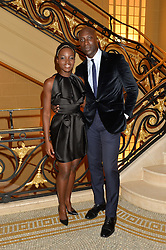 LUPITA NYONG'O and OZWALD BOATENG at the Sindika Dokolo Art Foundation Dinner held at The Cafe Royal, Regent Street, London on 18th October 2014.