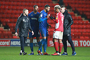 Charlton Athletic attacker Lyle Taylor (9) talking to AFC Wimbledon striker Jake Jervis (10) during the EFL Sky Bet League 1 match between Charlton Athletic and AFC Wimbledon at The Valley, London, England on 15 December 2018.