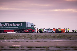 © Licensed to London News Pictures. 07/01/2019. Manston, UK. Truck drivers receive a briefing on the runway of disused Manston airfield as they take part in a no-deal Brexit planning exercise. Up to 150 lorries are going to test traffic conditions on the 20 mile route between Manston and the Port of Dover.  Photo credit: Peter Macdiarmid/LNP