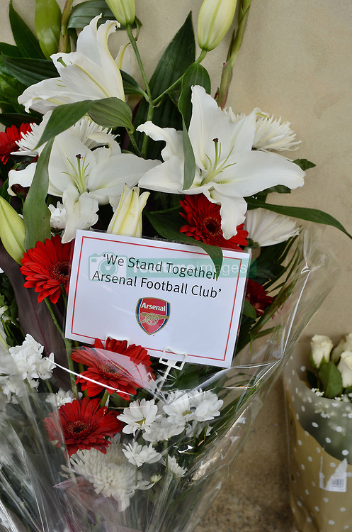 A bouquet of flowers from Arsenal football club left close to Finsbury Park Mosque in north London, after a van was driven into pedestrians near the north London mosque, leaving one man dead and eight injured.