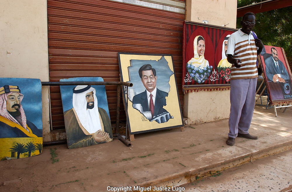 Khartoum. Sudan. An artist offers his portraits in a Khartoum street in downtown. The International Criminal Court ordered the arrest on Wednesday of President Omar Hassan al-Bashir of Sudan, charging him with war crimes and crimes against humanity for a concerted government campaign against civilians in the Darfur region.  (PHOTO: MIGUEL JUAREZ)