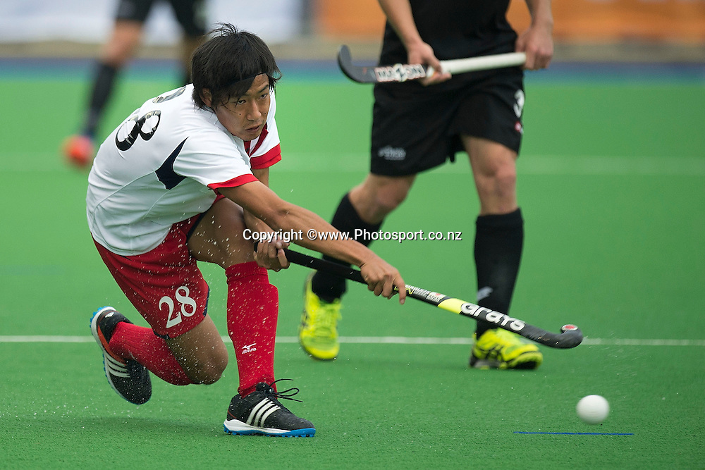 Suguru Hoshi of Japan makes a pass during the Black Sticks Men v Japan international hockey match at the Coastlands Kapiti Sports Turf in Paraparaumu on Friday the 22nd of November 2014. Photo by Marty Melville/www.Photosport.co.nz