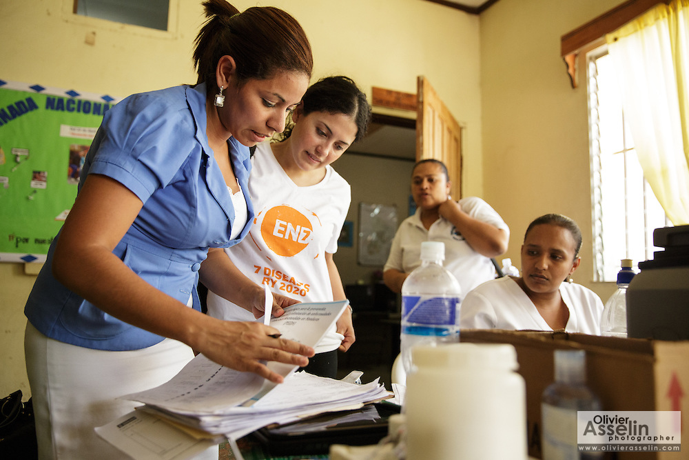 Sabin Institute senior program officer Karen Palacio, (second from left) listens to a health worker tell her about vaccination coverage from an ongoing campaign at the health center in San Esteban, Honduras on Thursday April 25, 2013.