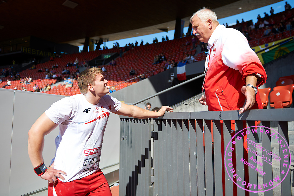(L) Jakub Szyszkowski of Poland with his (R) trainer coach Henryk Olszewski while men's shot put qualification during the First Day of the European Athletics Championships Zurich 2014 at Letzigrund Stadium in Zurich, Switzerland.<br /> <br /> Switzerland, Zurich, August 12, 2014<br /> <br /> Picture also available in RAW (NEF) or TIFF format on special request.<br /> <br /> For editorial use only. Any commercial or promotional use requires permission.<br /> <br /> Photo by &copy; Adam Nurkiewicz / Mediasport