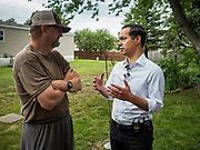 14 JUNE 2019 - WAUKEE, IOWA: JULIÁN CASTRO, right, Democratic presidential candidate and former Secretary of Housing and Urban Development during the Obama administration, talks to BRUCE MONTIS, a resident in Midwest County Estates, a mobile home community in Waukee, a suburb of Des Moines, Friday. Castro met with residents of the community to talk about affordable housing. Mobile County Estates was sold in March and the new owners are trying to hike rents for lots in the community by 69%, an amount residents say they can't afford. Castro is visiting Iowa to support his candidacy for the Democratic ticket of the US Presidency. Iowa traditionally hosts the the first selection event of the presidential election cycle. The Iowa Caucuses will be on Feb. 3, 2020.                                  PHOTO BY JACK KURTZ