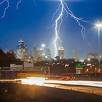 A thunderstorm above downtown Kansas City, Missouri yielding lighting strikes, June 25, 2016.