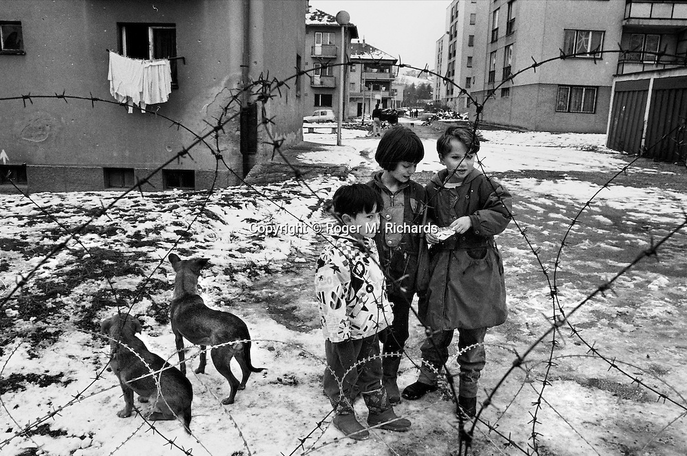 Serb children outside a camp for Italian NATO soldiers in the suburb of Vogosca, Sarajevo, Bosnia-Herzegovina, February 1996. PHOTO BY ROGER RICHARDS