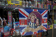 The faces of Prince Harry and Meghan Markle in a confectionary shop window as the royal town of Windsor gets ready for the royal wedding between the Prince and his American fiance, on 14th May 2018, in London, England.