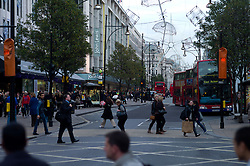 UK ENGLAND LONDON 23NOV11 - Street scene on busy Oxford Street outside the House of Fraser in the West End, central London.....jre/Photo by Jiri Rezac....© Jiri Rezac 2011