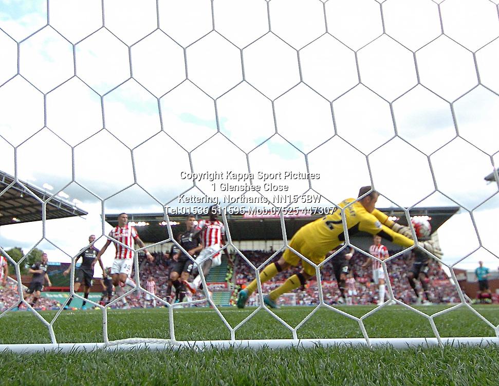 LIVERPOOL KEEPER SIMON MIGNOLET DENIES STOKES MAME DIOUF SHOT ON TARGET, Stoke City v Liverpool, Premiership, Britannia Stadium Sunday 9th August 2015