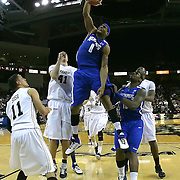 Memphis forward Will Coleman (0) slams the ball past Central Florida center Tom Herzog (41) and Central Florida guard Isaac Sosa (11) during a Conference USA NCAA basketball game between the Memphis Tigers and the Central Florida Knights at the UCF Arena on February 9, 2011 in Orlando, Florida. Memphis won the game 63-62. (AP Photo: Alex Menendez)