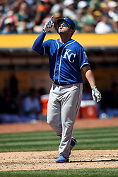 OAKLAND, CA - APRIL 17:  Mike Moustakas #8 of the Kansas City Royals celebrates after hitting a home run against the Oakland Athletics during the third inning at the Oakland Coliseum on April 17, 2016 in Oakland, California. (Photo by Jason O. Watson/Getty Images) *** Local Caption *** Mike Moustakas
