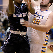 Hoggard's Qadhafi Turner attempts to shoot over Laney's Bert Rivenbark Tuesday at Laney. (Jason A. Frizzelle)
