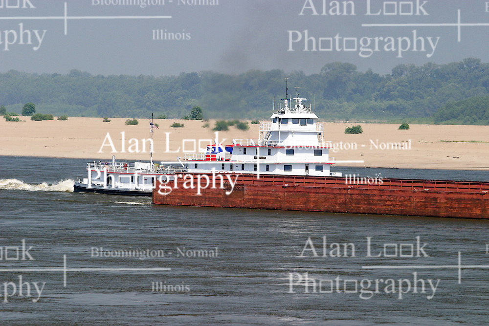 25 July 2005:   a tug boat pushes a barge on the Mississippi River near Tunica Mississippi.