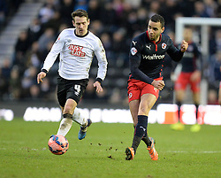 Reading's Hal Robson-Kanu passes the ball under pressure from Derby County's Craig Bryson - Photo mandatory by-line: Alex James/JMP - Mobile: 07966 386802 - 14/02/2015 - SPORT - Football - Derby  - ipro stadium - Derby County v Reading - FA Cup - Fifth Round