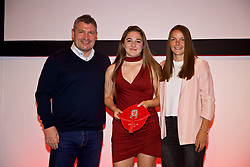 NEWPORT, WALES - Saturday, May 19, 2018: Grace Godwin is presented with her Under-16's cap by Osian Roberts (left) and Lauren Dykes (right) during the Football Association of Wales Under-16's Caps Presentation at the Celtic Manor Resort. (Pic by David Rawcliffe/Propaganda)
