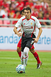 BANGKOK, THAILAND - Sunday, July 28, 2013: Liverpool's Iago Aspas in action against Thailand XI during a preseason friendly match at the Rajamangala National Stadium. (Pic by David Rawcliffe/Propaganda)