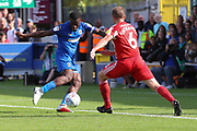 Sunderland midfielder Lee Cattermole (6) about to tackle AFC Wimbledon defender Deji Oshilaja (4) during the EFL Sky Bet League 1 match between AFC Wimbledon and Sunderland at the Cherry Red Records Stadium, Kingston, England on 25 August 2018.