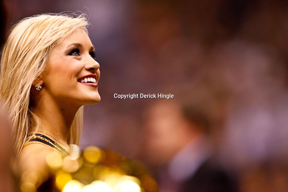 November 21, 2010; New Orleans, LA, USA; A New Orleans Saints Saintsations cheerleaders performs during the second half of a game against the Seattle Seahawks at the Louisiana Superdome. The Saints defeated the Seahawks 34-19. Mandatory Credit: Derick E. Hingle