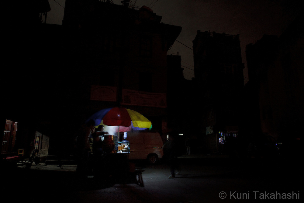 (Jan 6, 2012 - Kathmandu, Nepal).Street vendor sells food under no street lights during power outage in Kathmandu, Nepal, on Jan 6, 2012. For the last several years, nearly 800,000 people of the capital city faced up to 16 hours of blackouts every day, mainly caused by political instability. Nepal is said to be second only to Brazil in terms of water resources but the government has been incapable of harnessing hydropower..(Photo by Kuni Takahashi)