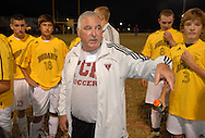 29 Sept. 2011 -- SPANISH LAKE, Mo. -- Trinity Catholic High School soccer coach Vince Drake instructs his players during halftime of Trinity's game with John F. Kennedy Catholic High School during alumni night at Trinity in Spanish Lake, Mo. Thursday, Sept. 29, 2011. Trinity players wear replica jerseys from Rosary High School, one of the predecessor schools to Trinity, which was formed in 2003. Photo © copyright 2011 Sid Hastings.