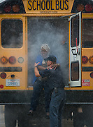 School bus drivers participate in disaster training at the Houston Fire Department training center, August 15, 2013.
