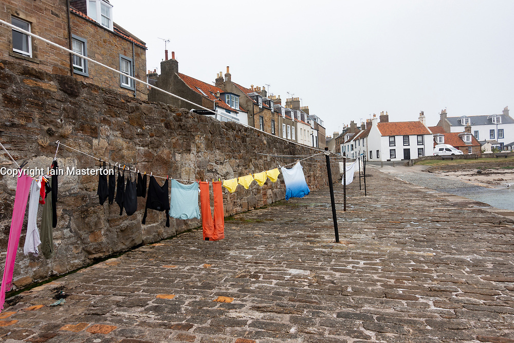 View of washing drying on Harbourside at village of Cellardyke in the East Neuk of Fife in Scotland, UK