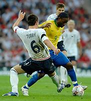 Photo: Richard Lane.<br />England v Brazil. International Friendly. 01/06/2007. <br />Brazil's Vanger Love breaks past England's John Terry.
