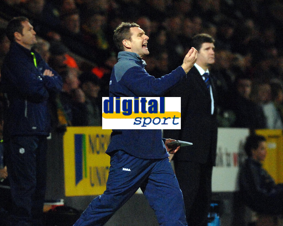 Photo: Ashley Pickering.<br />Norwich City v Sheffield Wednesday. Coca Cola Championship. 09/12/2006.<br />Norwich manager, Peter Grant (L) shouts his orders from the sideline while Sheffield manager Brian Laws looks on