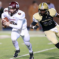 Thomas Wells | Buy at PHOTOS.DJOURNAL.COM<br /> East Webster quarterback Jack Wilson found himself surrounded by Bassfeild defenders for much of the night.