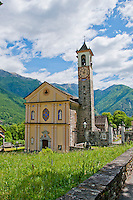 The old church and tower at Aurigeno, Ticino, Switzerland with it's yellow facade set in a beautiful alpine valley.