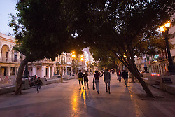 "North America, Caribbean, Cuba, Havana, people walking in ""Paseo del Prado""  in  Old Havana (La Habana Vieja), a UNESCO World Heritage Site, For Editorial Use Only"