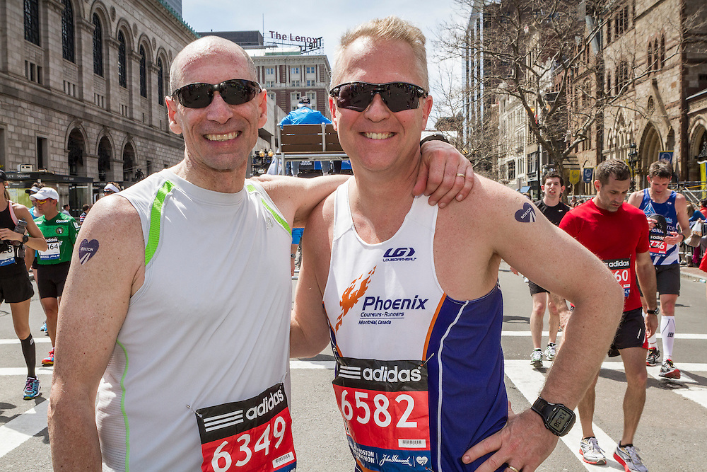 2014 Boston Marathon: happy finishers in recovery zone